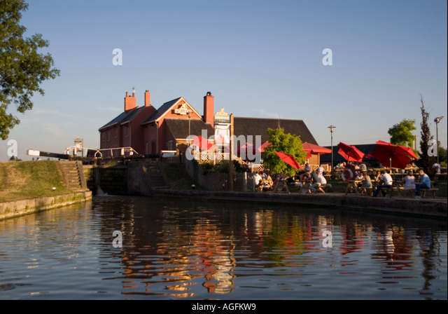 Traditional canal narrowboat at sunset on the Grand Union Canal - Stock Image