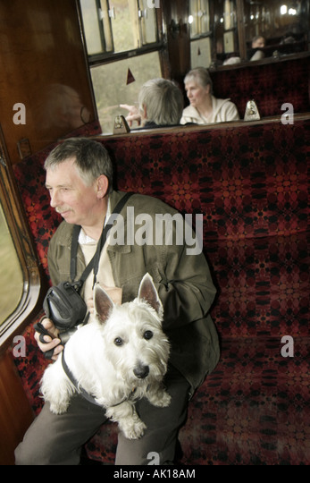 England UK Goathland North Yorkshire Moors Railway passengers man dog terrier - Stock Image