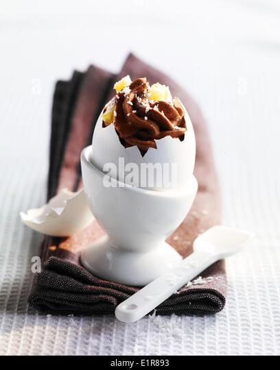 Chocolate,coconut and pineapple dessert served in an eggshell - Stock Image