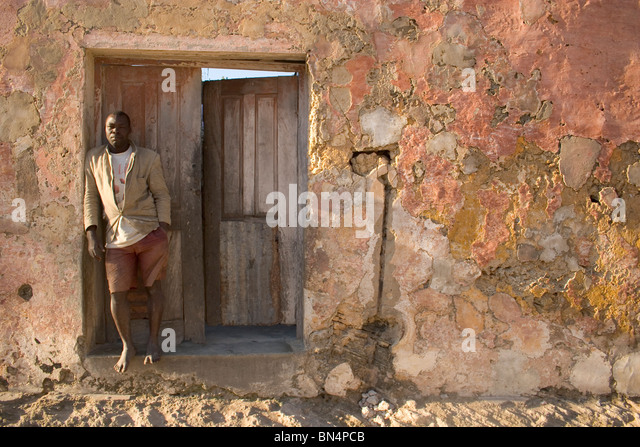 Man standing in doorway, Ilha de Mozambique - Stock Image