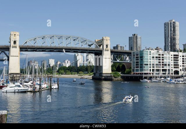 View from Granville Island across the bay showing Burrard St Bridge and downtown Vancouver, Canada - Stock Image