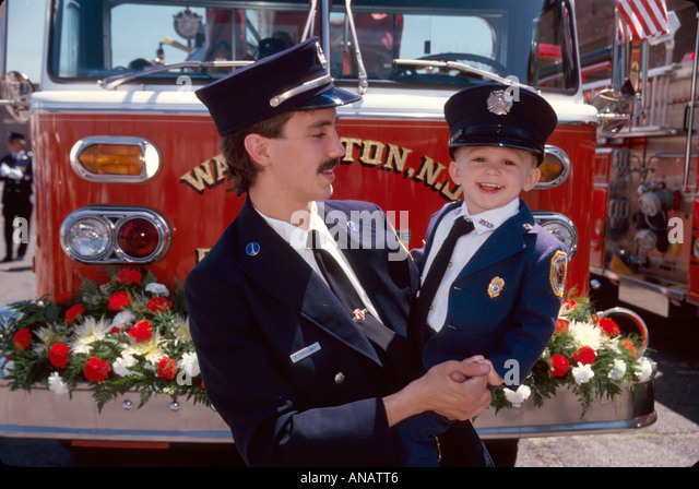 New Jersey Wallington father son fireman uniform family tradition community service role model - Stock Image