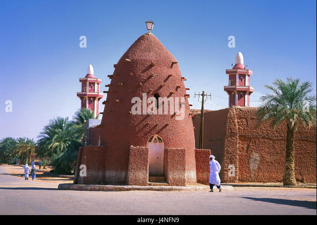 Algeria, oasis town of Timimoun, building, person, Africa, North Africa, desert, town, oasis, towers, structures, - Stock Image