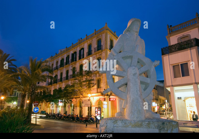 Spain Baleares island Ibiza town by night sculpture memorial to the sailor Hotel Montesol - Stock Image