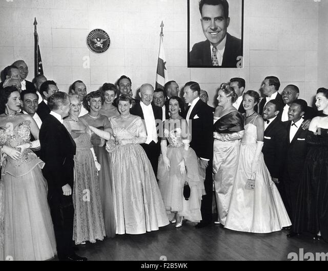 President Dwight and First Lady Mamie Eisenhower with guests attending the Inaugural Ball. Jan. 20, 1953. L-R: Guy - Stock Image