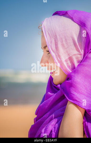 Woman with pink and purple scarves on head - Stock Image