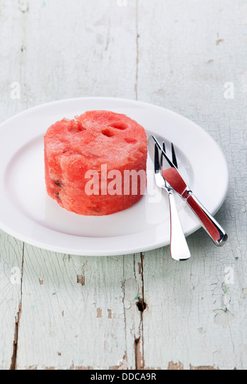Watermelon slice on white plate - Stock Image