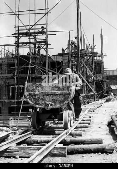 post war period, reconstruction, Germany, house construction, tipper, 1950s, rails, building site, under construction, - Stock Image