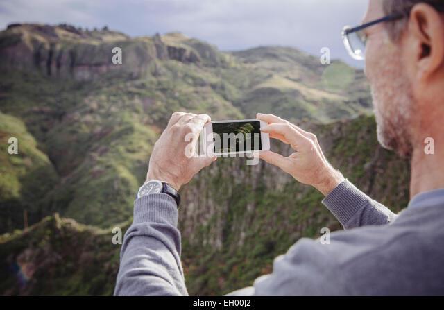 Spain, Canary Islands, Gran Canaria, man taking picture of Vega de San Mateo - Stock-Bilder