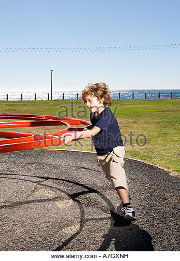 A young boy on a playground - Stock Image