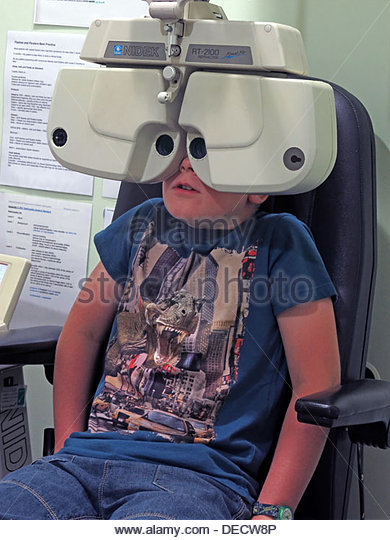 Schoolboy having eyetest at Specsavers Optician Unit 1, Golden Square, Warrington Cheshire England UK WA1 1TD - Stock Image