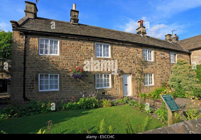 Plague Cottages Eyam Derbyshire Peak District National Park England UK - Stock Image