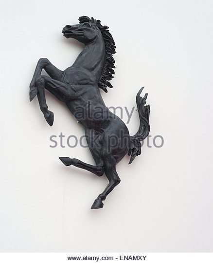 ferrari horse statue. ferrari horse logo in the wall - stock image statue