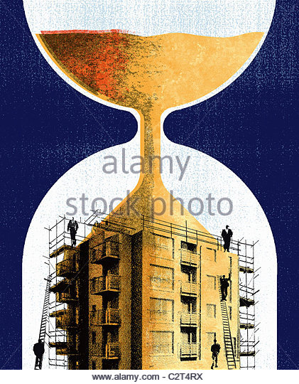 Hourglass sand running into building with scaffolding - Stock Image