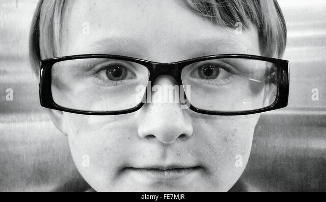 Portrait Of Boy Wearing Eyeglasses - Stock Image