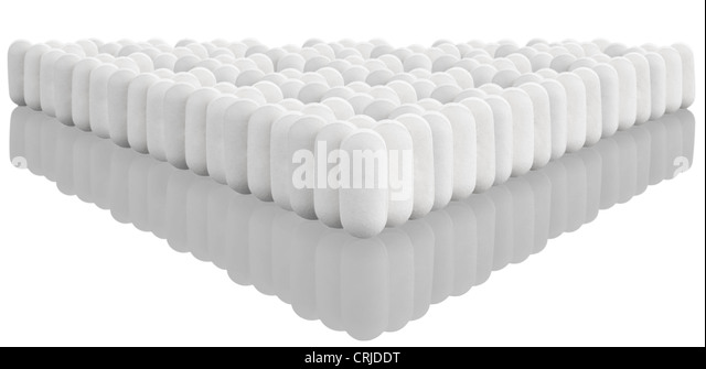 multiple white pills with reflection - Stock Image