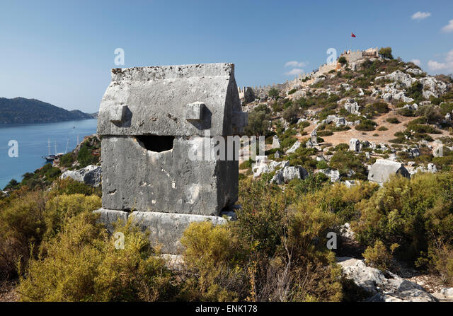 Lycian sarcophagus and castle, Simena (Kalekoy), Kekova, Lycia, Antalya, Mediterranean Coast, Southwest Turkey, - Stock Image