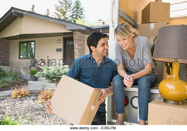 Couple talking at back of moving van - Stock Image