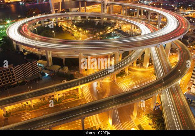 Traffic on roundabout leading to Nanpu bridge at dusk; Dongjiadu: Shanghai; China - Stock Image