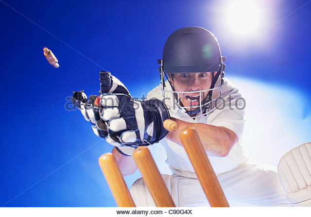 Cricket player lunging for bats - Stock Image