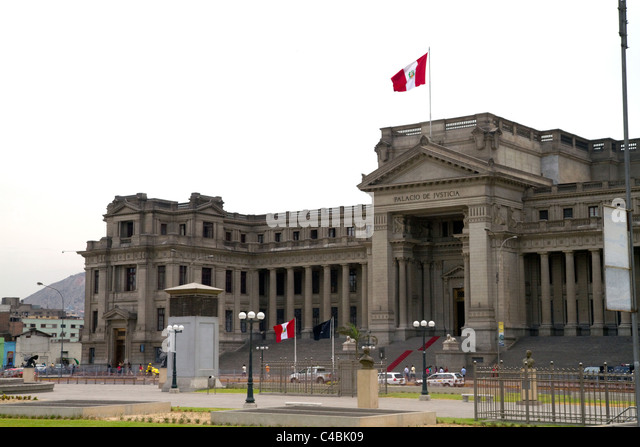 The Palace of Justice and the state flag of peru located in the Lima district of Lima, Peru. - Stock Image