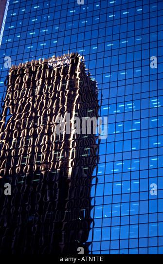 Skyscraper reflected in glass on another - Stock Image
