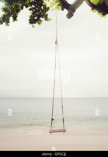 A beach swing on a quiet beach in Thailand. - Stock Image