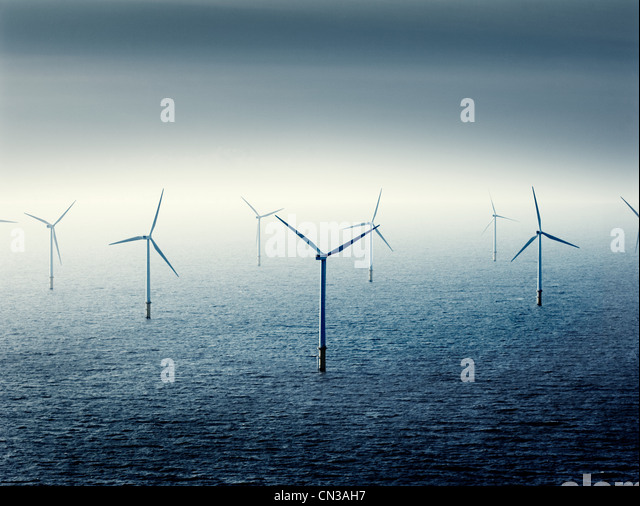 Wind farm at sea - Stock Image