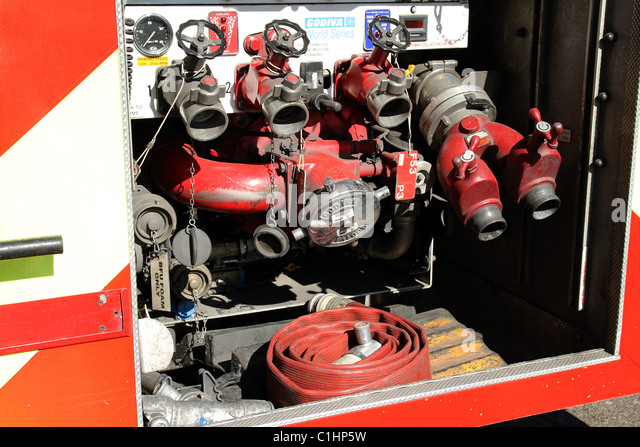 UK. FIRE BRIGADE HOSES IN AN EMERGENCY LORRY IN LONDON - Stock Image
