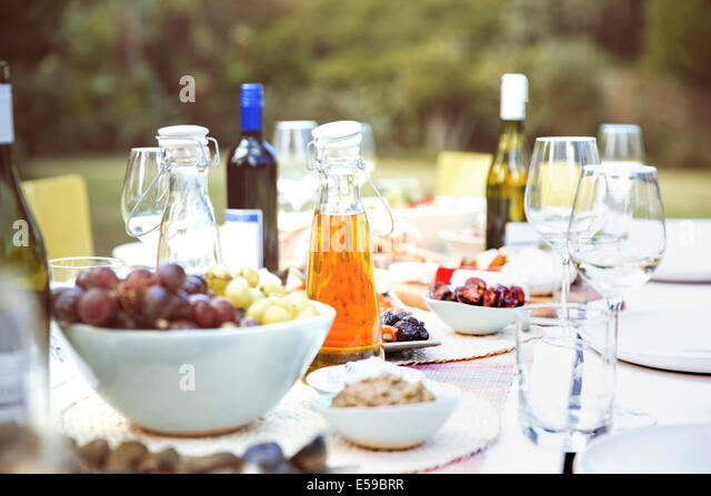 Set table at party outdoors - Stock Image