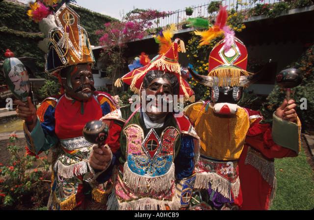 Guatemala La Antigua colonial capitol until earthquake costumed dancers Mayan ceremonial masks - Stock Image