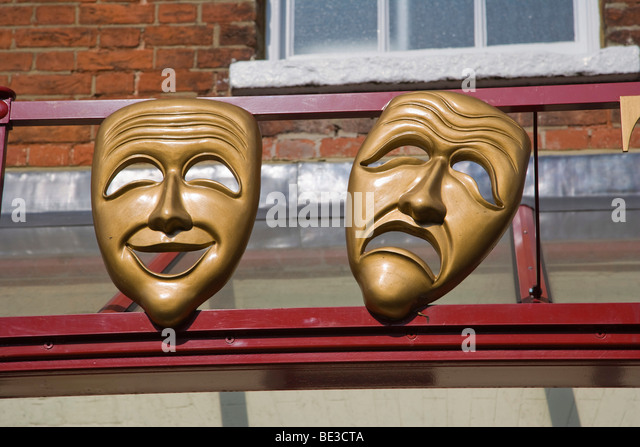 Masks of Comedy and Tragedy muses on the facade of Kenton Theatre on New Street, Henley-on-Thames, Oxfordshire, - Stock Image