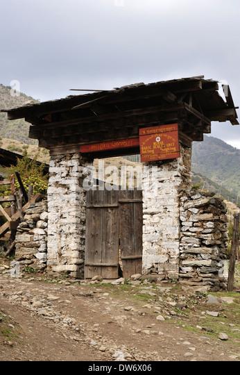 Stone gate, village of Merak on Merak Sakteng trek, Eastern Bhutan - Stock Image