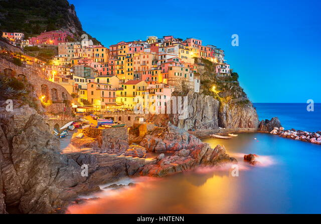 Manarola at evening dusk, Cinque Terre, Liguria, Italy - Stock Image