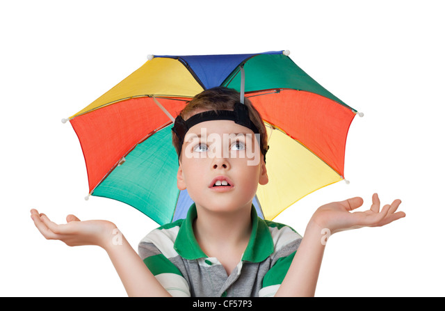boy with multi-coloured umbrella on head spread his hands aside  isolated on white background - Stock Image