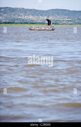 People in boat traveling on Ayeyarwady River - Stock-Bilder