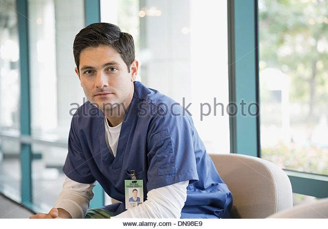 Portrait of confident male nurse - Stock Image