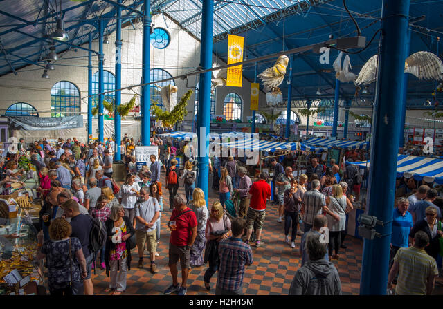 Visitors browsing food stalls,in the market hall, Abergavenny Food Festival, Monmouthshire, South Wales, UK - Stock Image