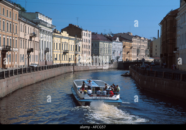 Russia former Soviet Union St. Petersburg tour boat canal near Hermitage Winter Palace - Stock Image