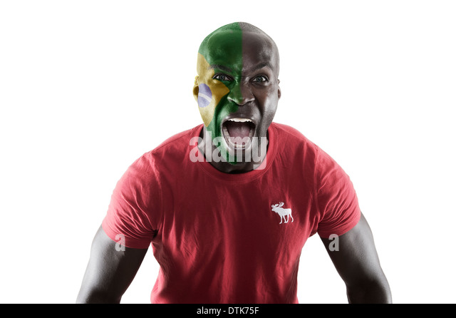 Man with face paint cheering on Brazil - Stock Image