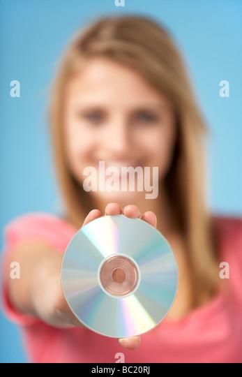 Teenage Girl Holding DVD - Stock-Bilder