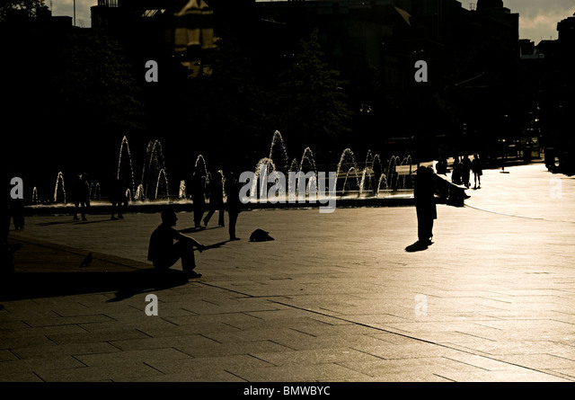 people playing and relaxing in the sun in Nottingham market square - Stock Image
