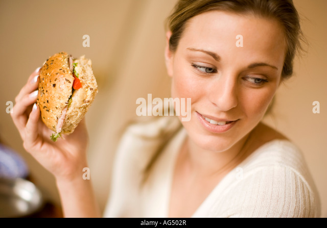 Blonde girl eating healthy sandwich - Stock-Bilder