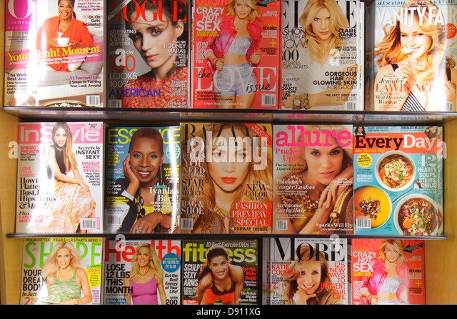 California Los Angeles International Airport LAX concourse gate area terminal shopping consumer magazines women's - Stock Image