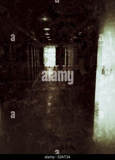 Unknown in a dark hallway - Stock Image