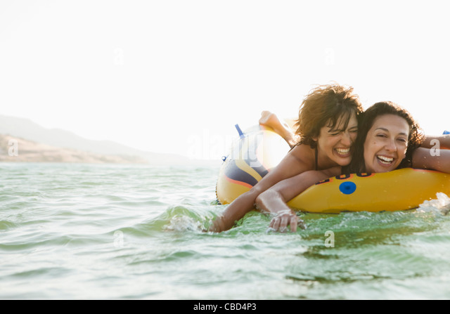 Women in inflatable boat in water - Stock Image