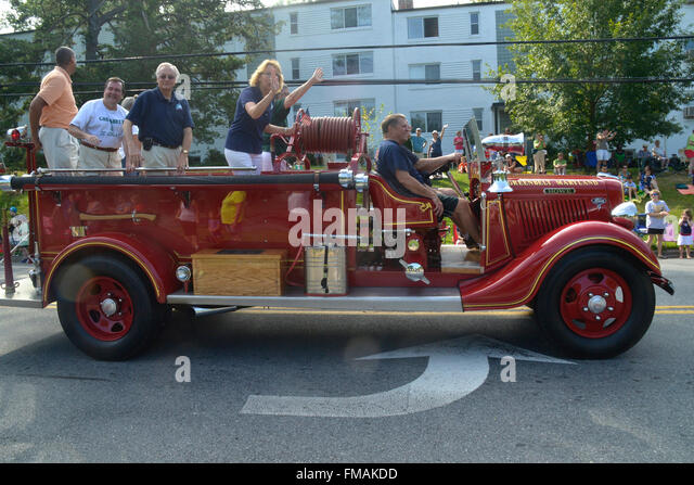 Greenbelt's City Council rides on a antique fire truck in Greenbelt's Labor Day parade; - Stock Image