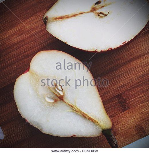 High Angle View Of Halves Pear On Table - Stock Image