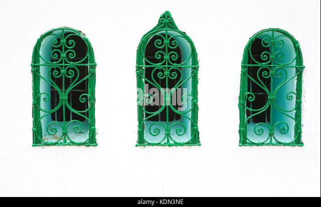 Morocco,Tetouan, historical Medina typical window in whitewashed facade bordered in turquoise - Stock Image