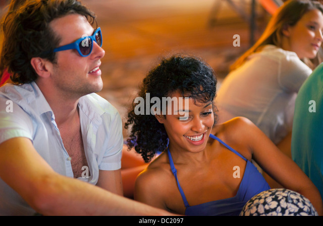 Young couple at indoor beach party - Stock Image